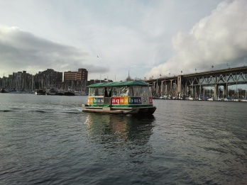 A water taxi crossing False Creek in downtown Vancouver