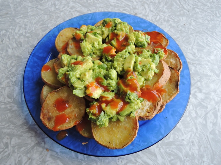 Sweet-potato chips with guacamole and hot sauce