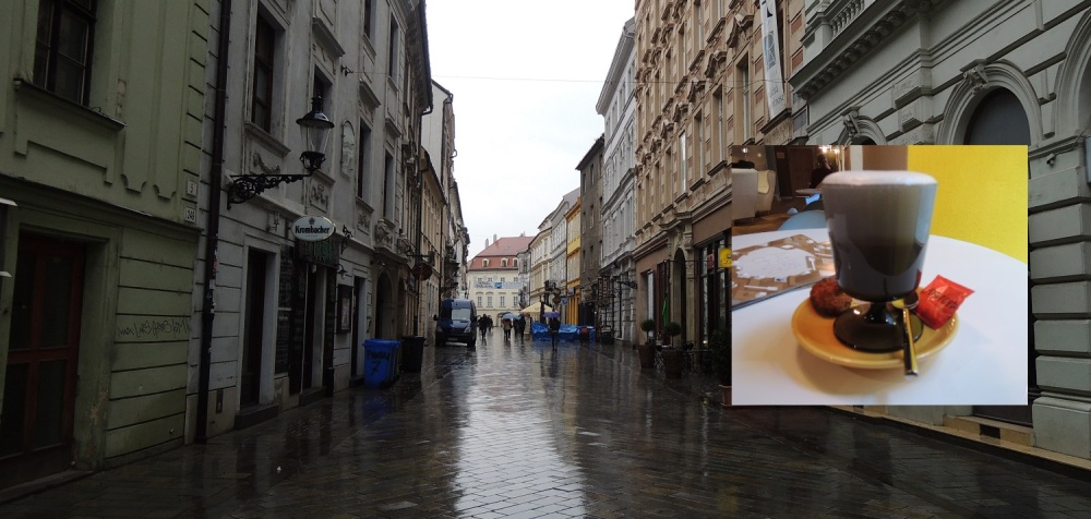Bratislava's rainy historic center, and my Foxford latte to the right.